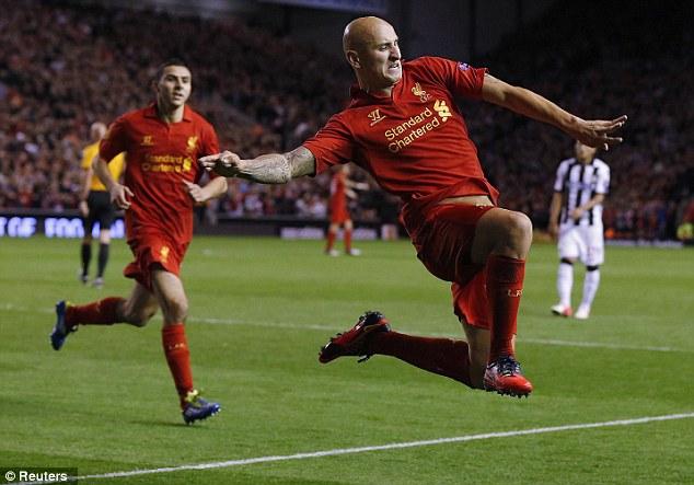 Best foot forward: Liverpool's Jonjo Shelvey celebrates after scoring against Udinese