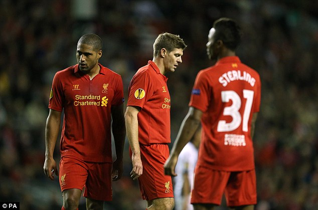 Mixed emotions: Steven Gerrard and the Liverpool players look dejected after the defeat as the Udinese players celebrate their famous win (below)