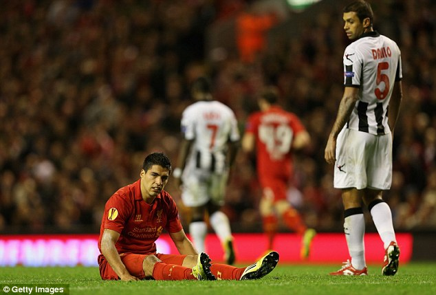 Bad night at the office: Luis Suarez looks disappointed with the result at the final whistle