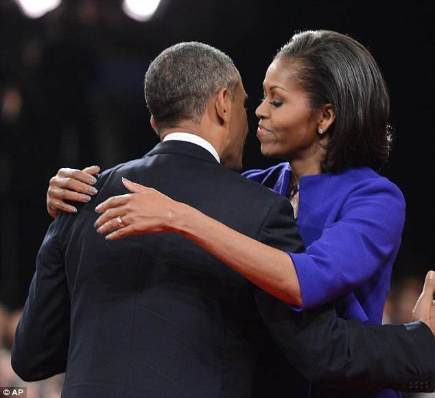 President Barack Obama hugs First lady Michelle Obama after the first presidential debate at the University of Denver, last nigh