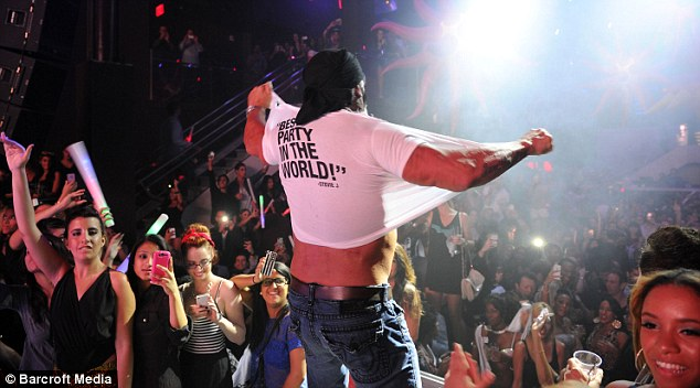 Best party in the world: At least that's what the wrestler's ripped T-shirt proclaims