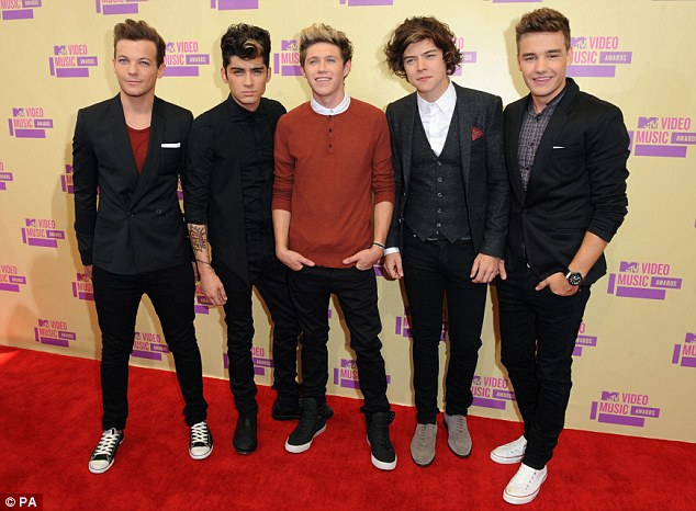 One Direction (from left, Niall Horan, Zayn Malik, Liam Payne, Harry Styles and Louis Tomlinson), who were the inspiration behind Emily's short story Loving The Band