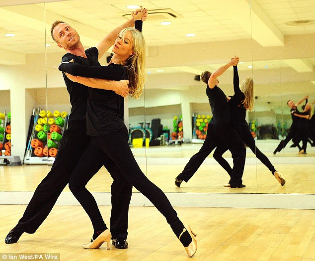 Serious face: The 38-year-old star remained focused as they pulled dance poses in front of the mirror