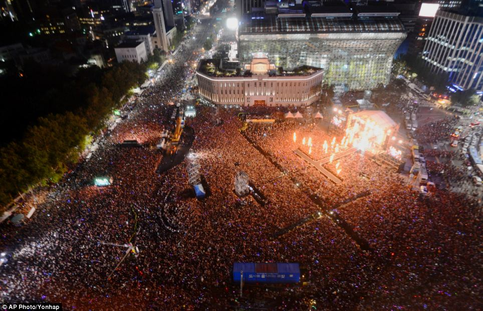 Huge: More than 80,000 people crammed into the plaza in front of Seoul City Hall to see South Korean rapper Psy perform his hit song Gangnum Style last night