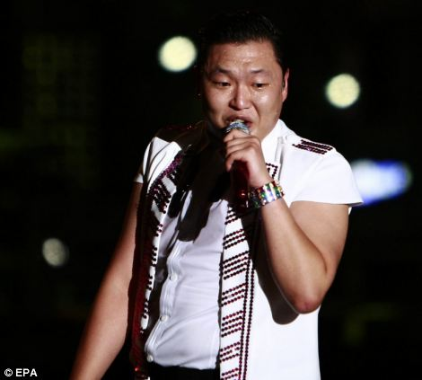Psy performs on stage during his free public concert in front of Seoul City Hall