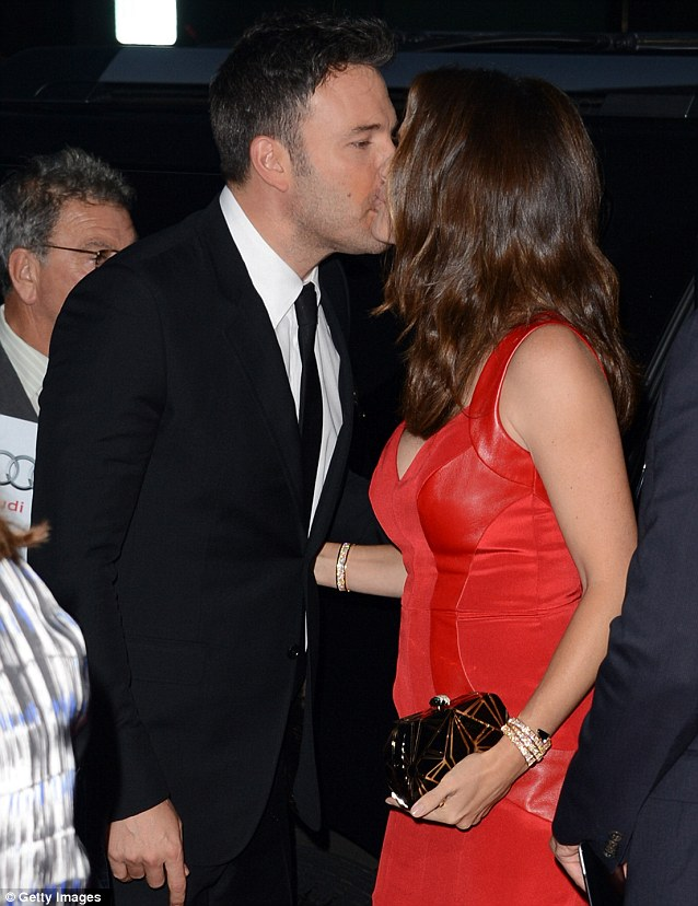 Sealed with a kiss: Garner stole a smooch with husband Ben Affleck at Thursday's event