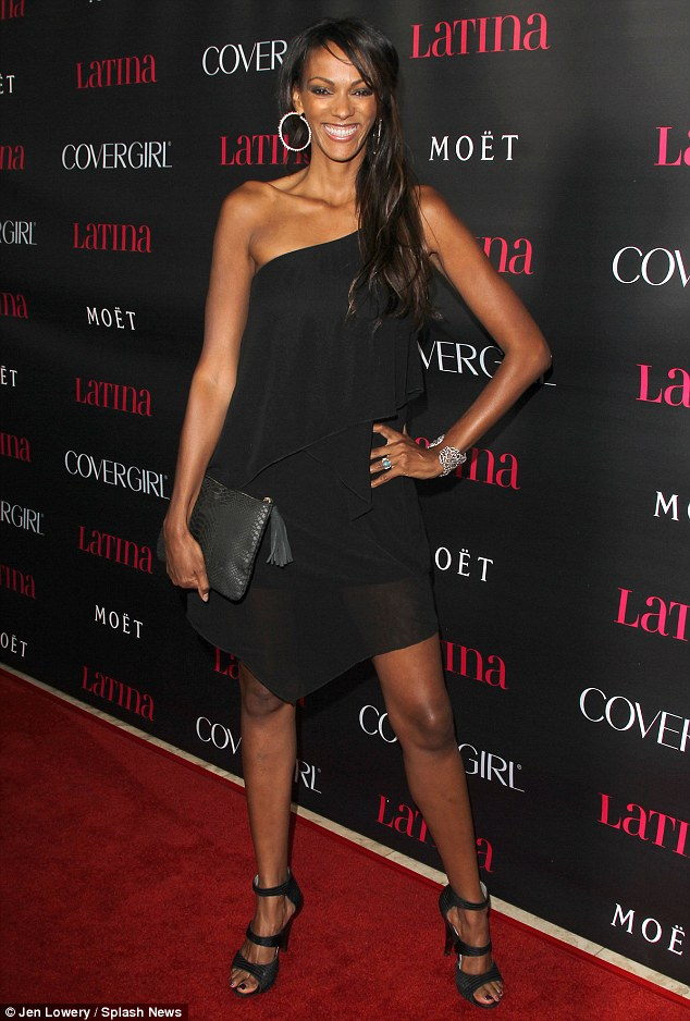 Time to shine: Judi Shekoni makes the most of her spot in the limelight as she hits the red carpet at the Latina Magazine party in LA