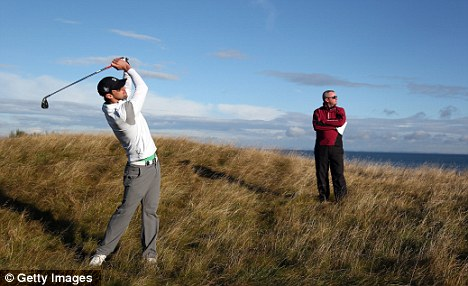 All-rounder: Swimmer Michael Phelps proved his golfing talent with a 53yd putt at the Dunhill Links Championship