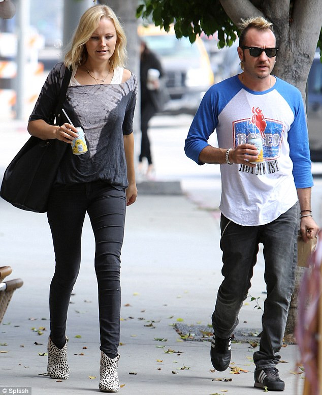 Looking good: Malin showed of her fabulous figure as she went on a walk with Roberto Zincone in Hollywood on October 5