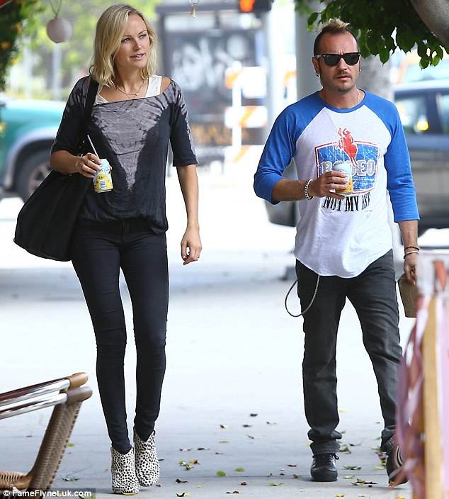 Fruity: It seems the sexy singer and actress was enjoying a can of juice as they enjoyed their stroll