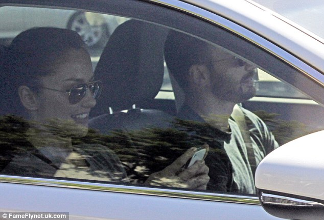 Happy again: The Hollywood stars, who confirmed that they were back together after a very public display of affection on Monday, spent Tuesday morning together, driving through Hollywood in Chris' white Lexis