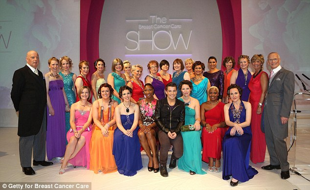 All 24 models involved in the Breast Cancer Care Show pose with Joe McElderry and Denise Richards, front centre