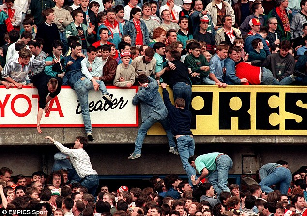Tragic: Liverpool fans try to get away from the crush