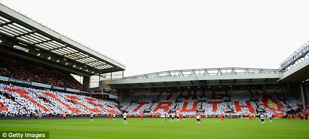 Support: Liverpool fans hold up a mosiac spelling out 'justice' and 'the truth'