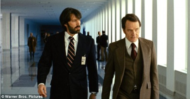 Film magic: Affleck stars as CIA agent Tony Mendez, pictured with co-star Bryan Cranston in Argo