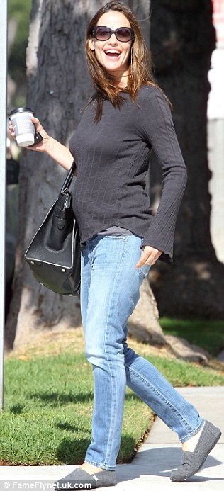 Before the glamour: Garner appeared in casual jeans and sweater earlier today