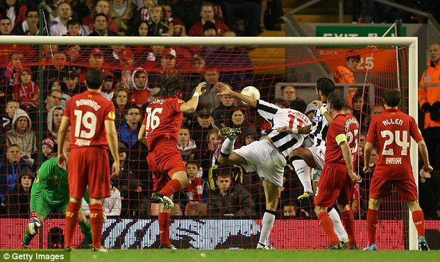 Blunder: Sebastian Coates (third left) scores an own goal to condemn Liverpool to defeat at Anfield