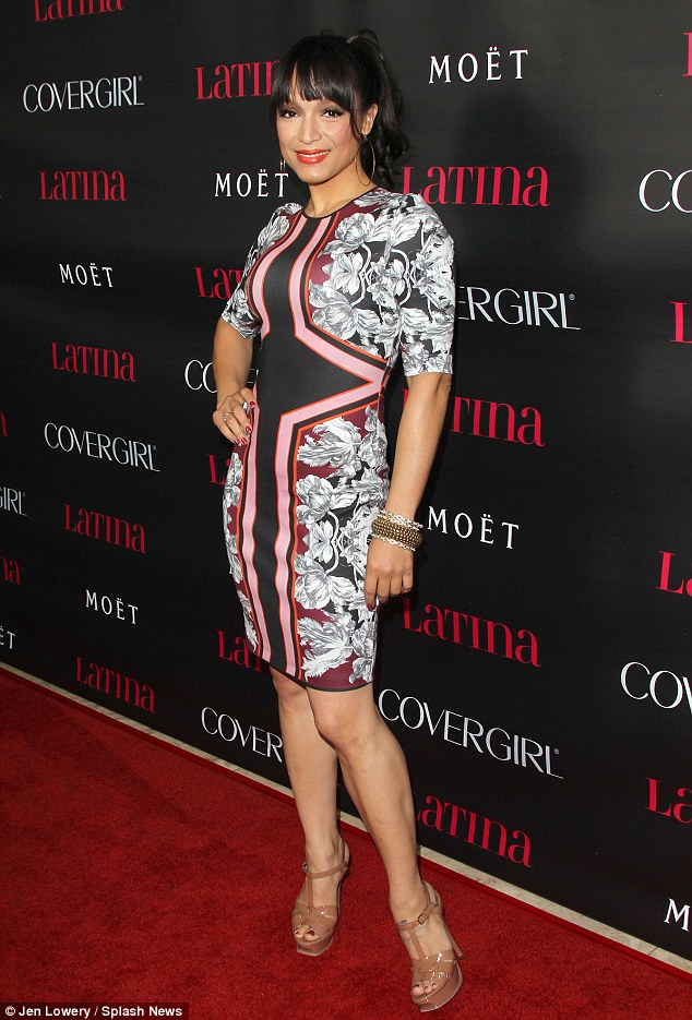 Knock-out: Prince's former wife Mayte Garcia opts for a print dress as she poses on the red carpet