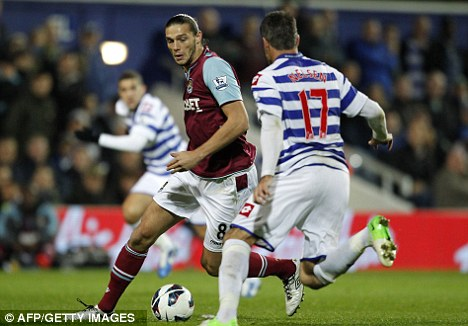 Big ask: Arsenal will have to keep West Ham striker Andy Carroll quiet