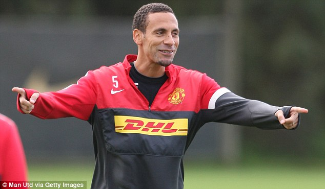 Pointing the way: Rio Ferdinand smiles during training at Carrington on Friday morning