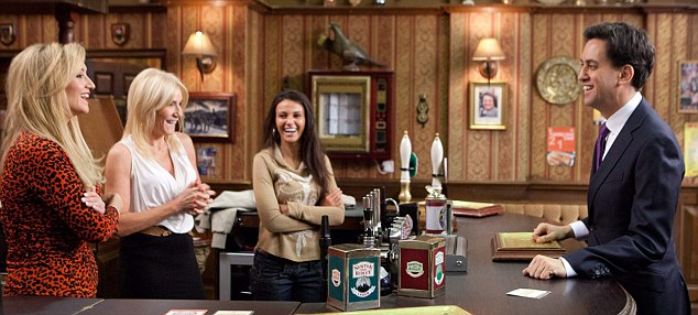 All smiles: Ed Miliband enjoys a joke with Catherine Tyldesley, left, Michelle Collins, middle, and Michelle Keegan, right, during his trip to the Rovers Return