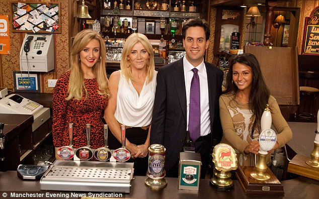 Cheers to me: Miliband pictured with the cast during his trip to the soap's famous set