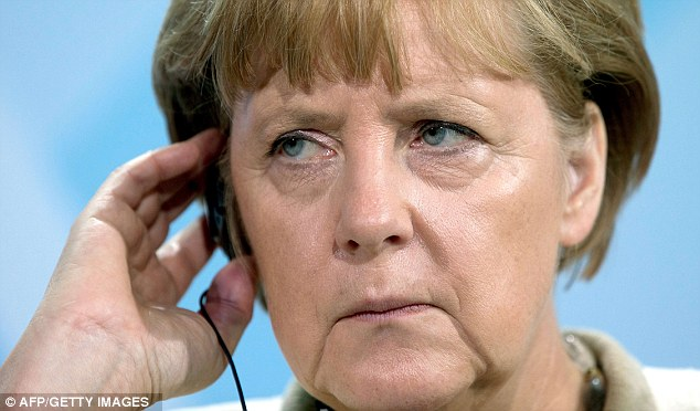 Larger share: German Chancellor Angela Merkel, pictured, is pushing for a 9 per cent share in the combined company