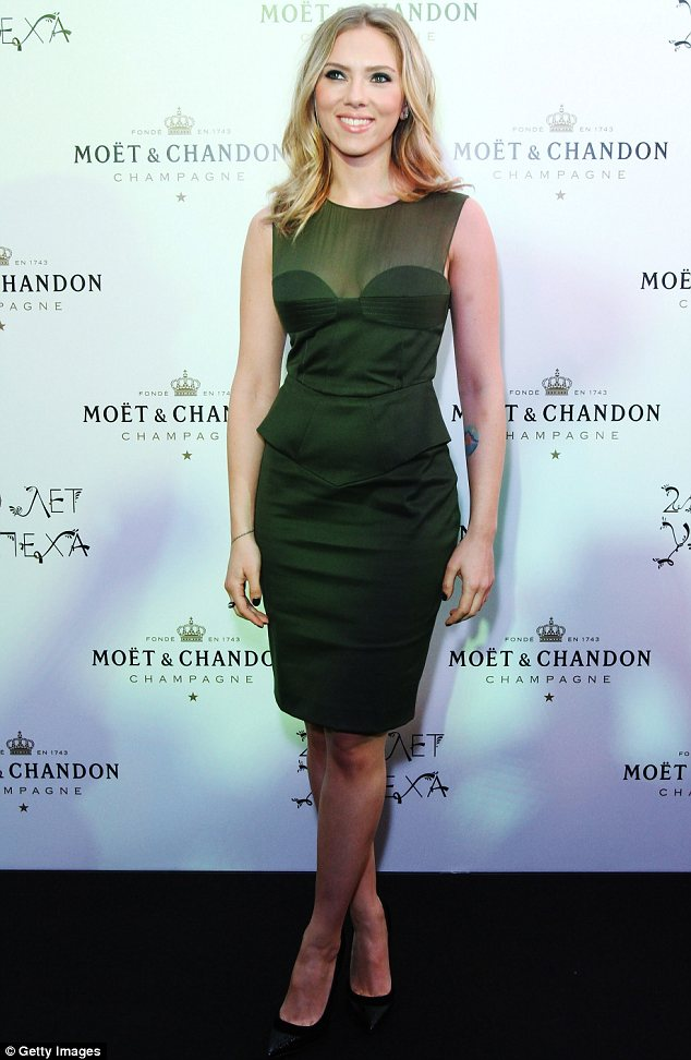 Green goddess: Scarlett Johansson turned heads in a moss green dress at Moet and Chandon's 250th anniversary party in Moscow, Russia on Thursday