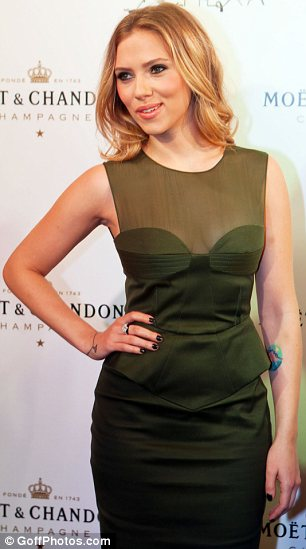 Fantastic Form: The actress' frock clung to her slim yet curvy figure as she posed up on the red carpet