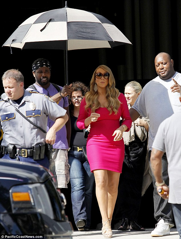 Playing safe: Mariah Carey stepped out with a bulky security team in Baton Rouge, Louisiana on Friday