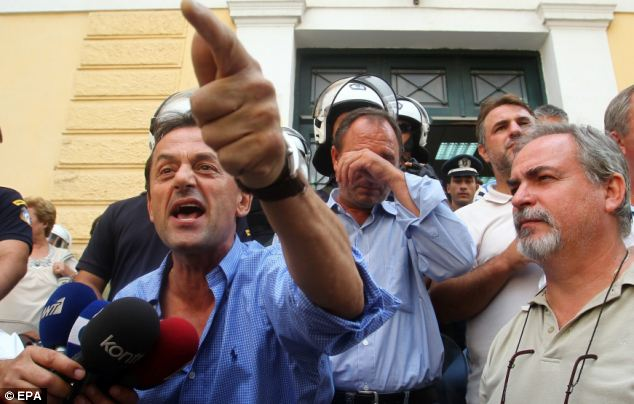 Angry and emotional workers defend the actions of their colleagues outside the court to the press and public