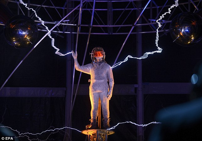 Bolts from the blue: Blaine has been standing in the middle of a million volts of electric current streamed by Tesia coils for his stunt Electrified