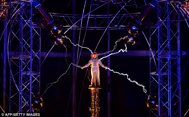 Sparks fly: Thousands of volts from the coils stream towards David Blaine and through his steel suit