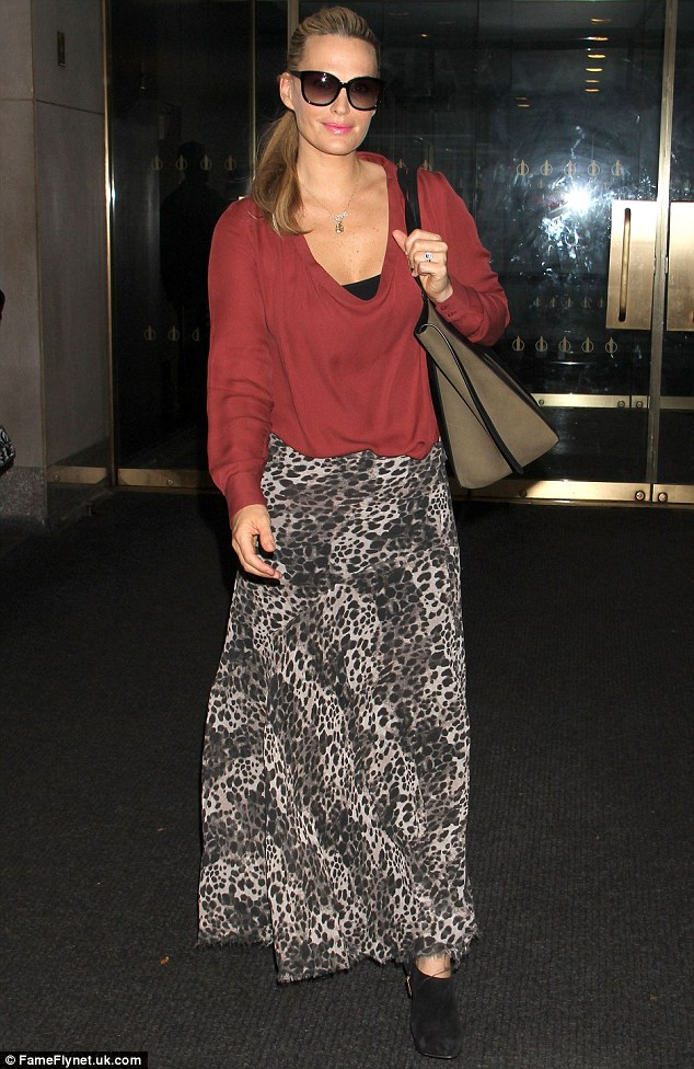 Going boho: Molly strolled through NBC studios in New York City in her black-and-white leopard print skirt and baggy sweater