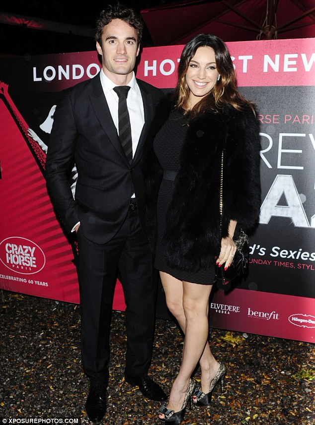 Date night: Kelly Brook and Thom arrived on a rainy evening for the the late-night cabaret show on London's Southbank