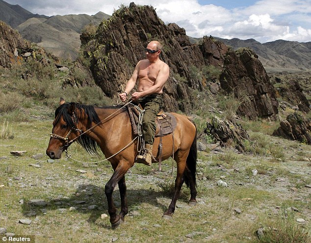 Action man: Vladimir Putin is often pictured partaking in various sporting activities - often topless - such as horse riding in southern Siberia's Tuva region