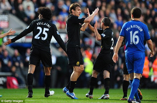 Back in it: Nikica Jelavic (centre) bagged the equaliser for Everton one minute after Kone's strike