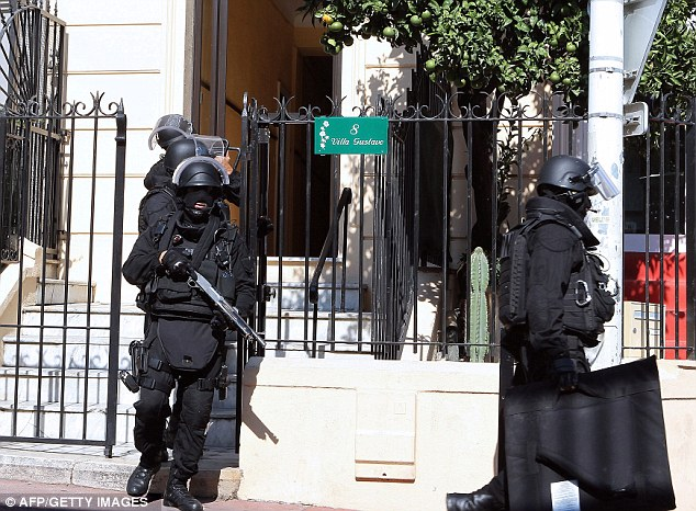 Heavily armed: Police officers wore full protective clothing including bullet proof vests, helmets and shields