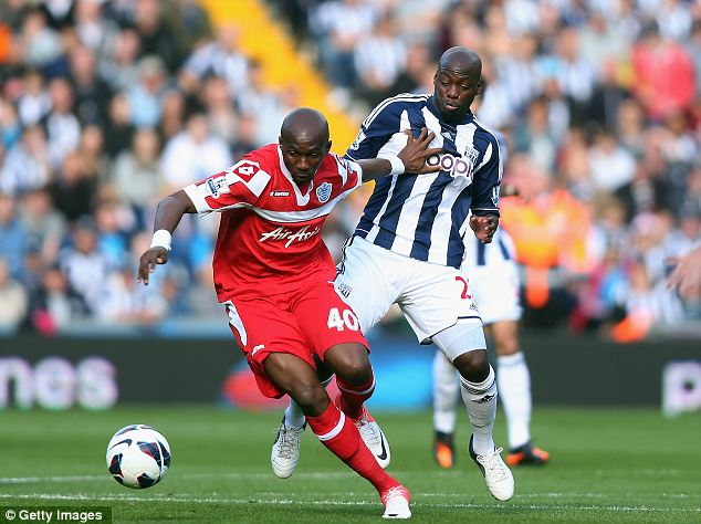 Hand off: Stephane Mbia of Queen Park Rangers