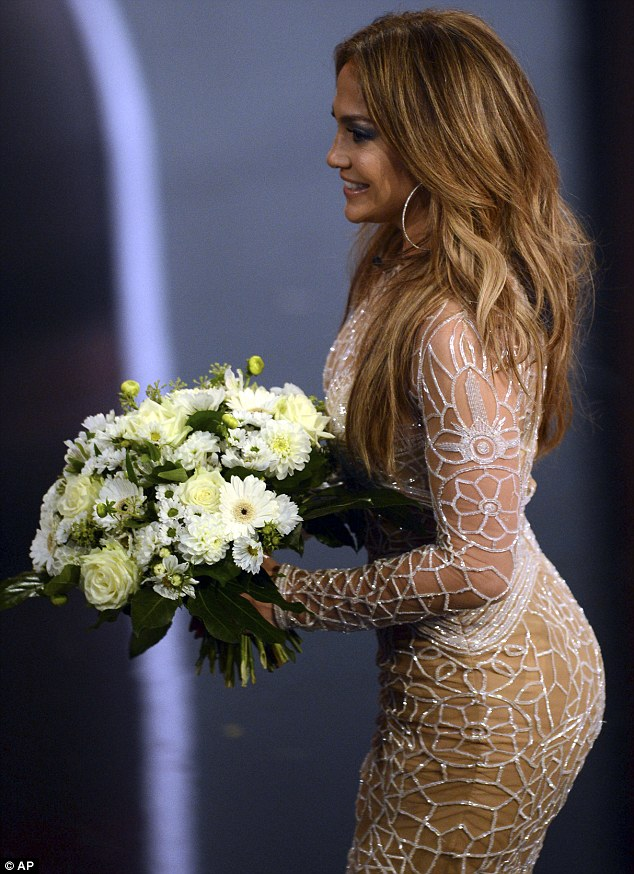 Skin-tight: 43-year-old Jennifer squeezes her curves into a tight, nude dress for the TV show