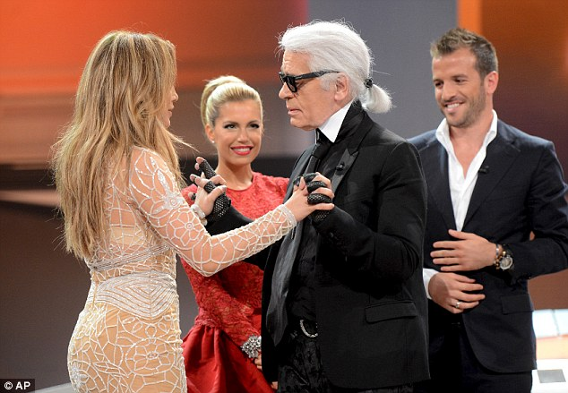 Old friends: Jennifer and Chanel's Karl Lagerfeld chat during the show
