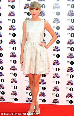 A vision in white: Taylor Swift also attended the awards, but lost out on one herself