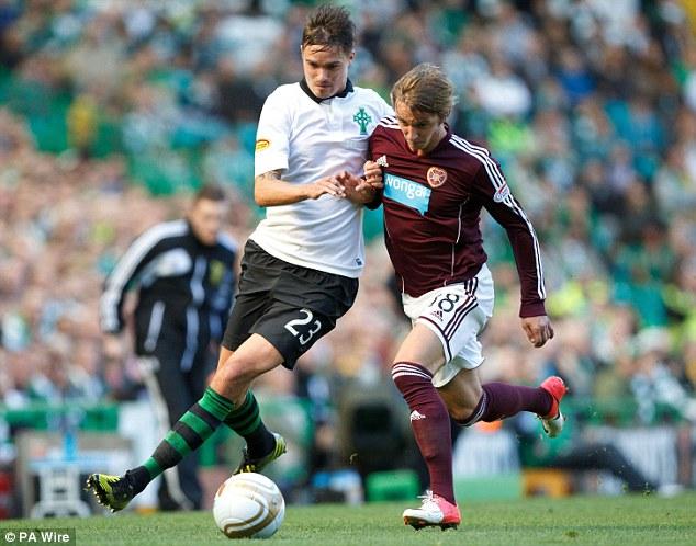 Battle: Celtic's Mikael Lustig clashes with Arvydas Novikovas