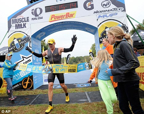 Crossing the line: Lance Armstrong finishes the triathlon