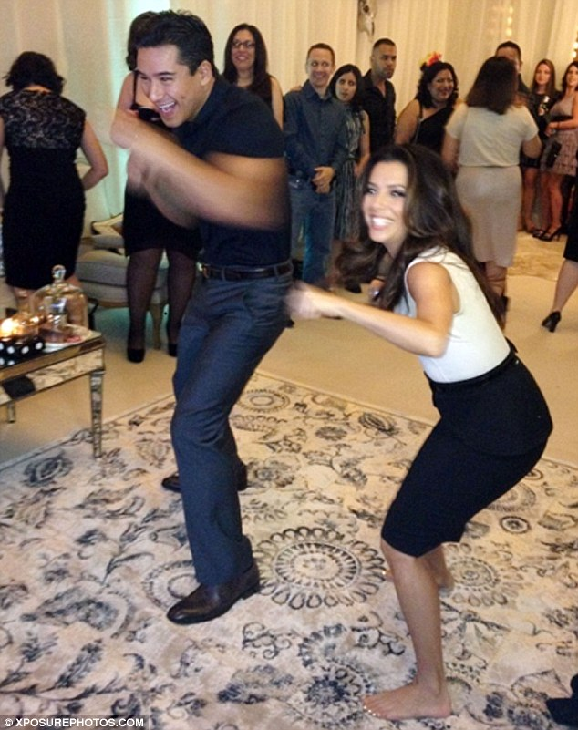 The heels are off! Eva Longoria whips off her stilettos to play Xbox with best pal Mario Lopez at her Eva's Heroes Casino Night in San Antonio, Texas on Saturday night