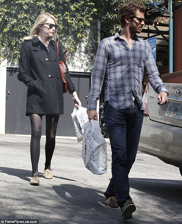 Brought to book: Andrew Garfield managed to persuade Emma Stone to join him at a book shop in Hollywood on Sunday