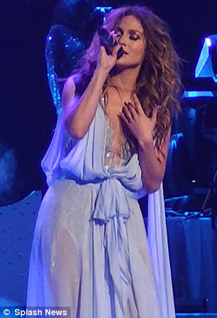 A softer look: JLo donned a billowing pastel blue gown as she cooled down with a ballad