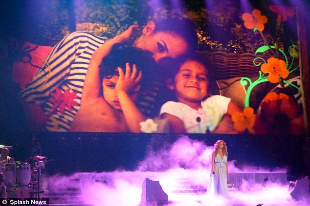 Her little loves: The singer shared a sweet snap of herself with four-year old twins Max and Emme while on stage