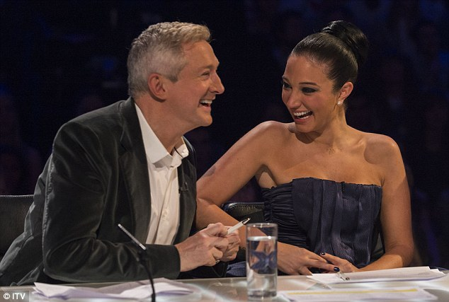 Bonding: Louis Walsh and Tulisa Contostavlos shared a joke during the show
