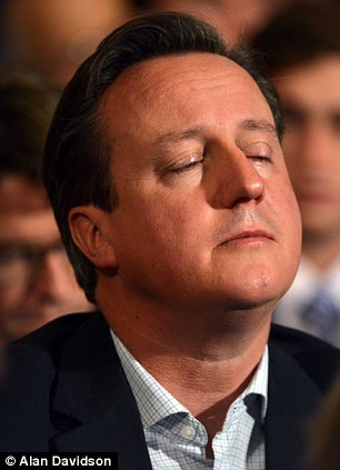 David Cameron closes his eyes as he listens to William Hague's speech